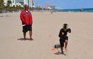 Tovani pulling sleds @ beach workout 2/2/13