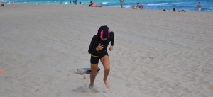 Taliyah pulling sleds @ beach workout 2/2/13