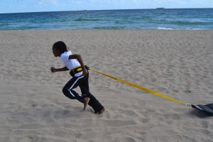 Tori pulling sleds @ beach workout 2/2/13