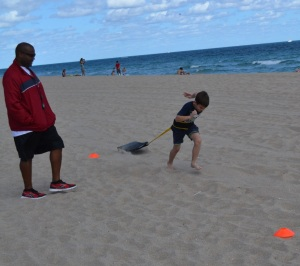 Jules pulling sleds @ the beach workout 2/2/13