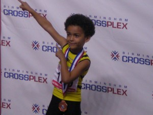 Tre @ AAU Indoor Nationals receiving his medal for 800m doing Bolt pose LOL!!!!