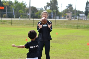 Tre throwing a perfect pass to Coach Amanda